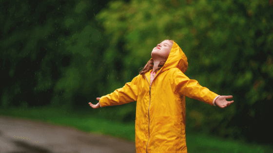 Girl standing in the rain