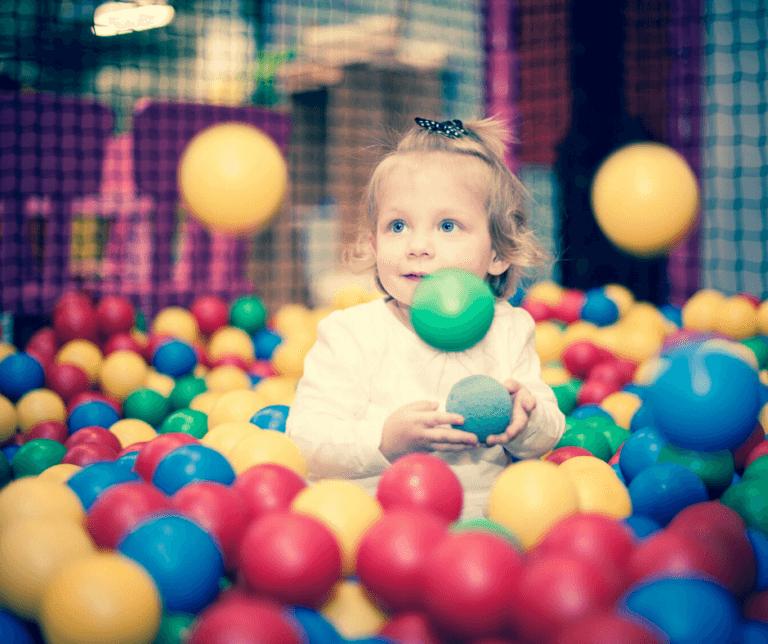 kid in ball pitt